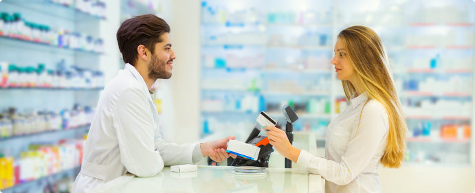 male pharmacist assisting a beautiful woman