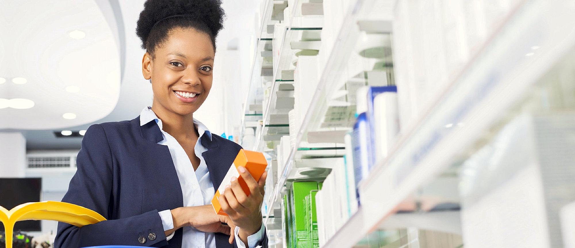 female pharmacy customer smiling