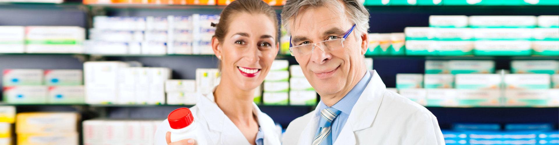 senior pharmacist and female pharmacist smiling