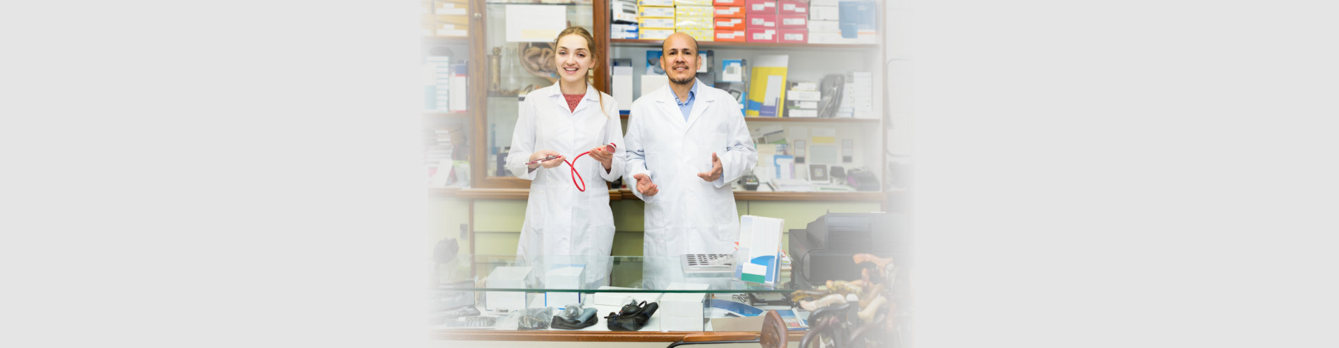 two orthopedists working in special store with orthopedic goods